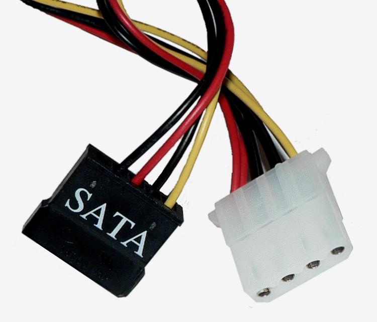 图中黑色的是SATA硬盘的电源线,白色的是IDE硬盘电源线